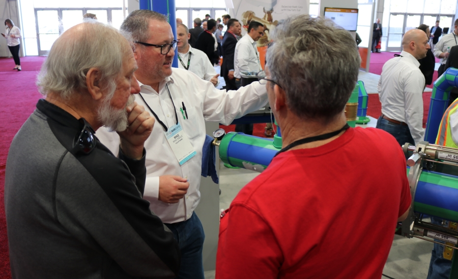 Aquatherm's Mike Engle demonstrates the hot tap at the 2017 AHR Expo in Las Vegas