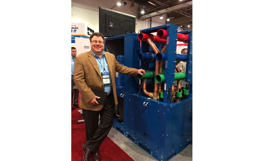 Waterfurnace Intl.'s Alan Niles showcases the WC Dual Scroll Chiller, which can heat and cool simultaneously, during the 2017 AHR Expo in Las Vegas