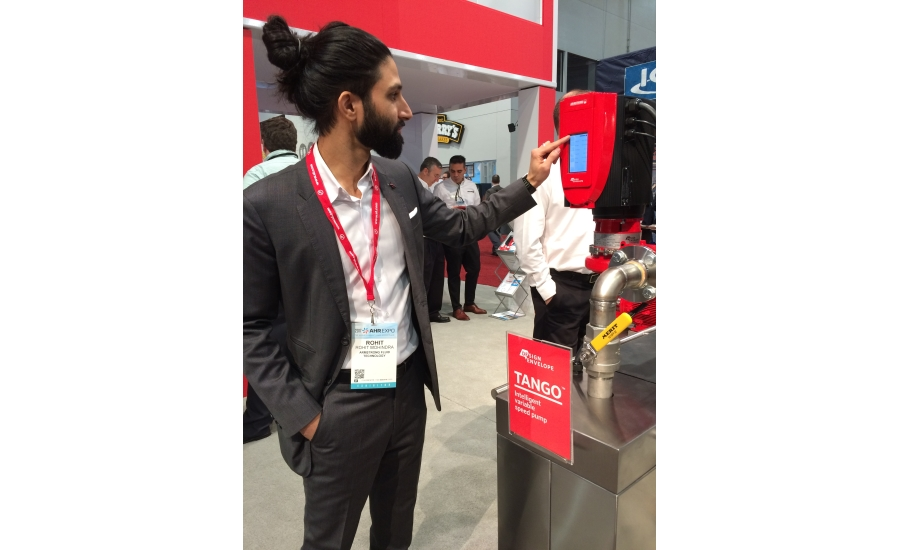 Armstrong Fluid Technologies' Rohit Mohindra demonstrates the company's new Design Envelope Tango Pump at the 2017 AHR Expo in Las Vegas
