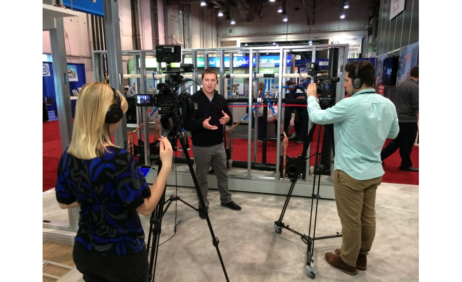 Uponor's Daniel Worm films a video booth tour with BNP Media's video team at the 2017 AHR Expo in Las Vegas