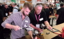 Contractors visiting the REHAU booth got a product demonstration mixed with a feeling of competition as they became familiar with the new PEX tools available