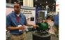 Metraflex Co. Product Manager Jeremy Wright showcases the style ABD strainer at the 2017 AHR Expo in Las Vegas