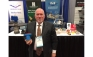 Milwaukee Valve's Joe Myers poses with the MS Insulator valve handle during the 2017 AHR Expo in Las Vegas