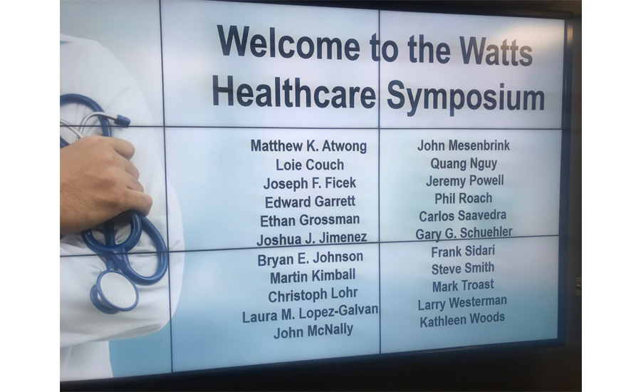 A welcome sign to all attendees of the Watts Healthcare Symposium
