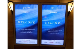 A welcome sign to the grand opening celebration for the new Moen showroom