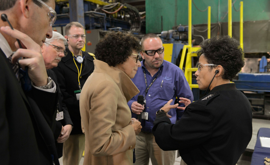 Adm. Michelle Howard, vice chief of Naval Operations, speaks to the owner of the Milwaukee Valve Company, Diane Seder.