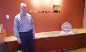 Olson with Dunham logo