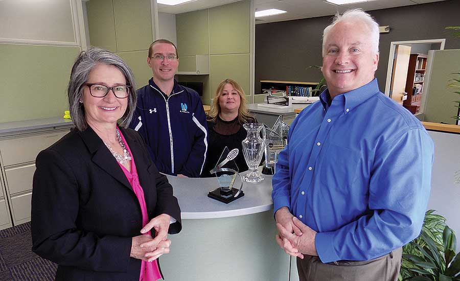 From left: Kathy Dwer, Jim Fowler, Karen Faulconer and Ned Dwyer help form a family feel for the nine-person staff at E.J. Dwyer