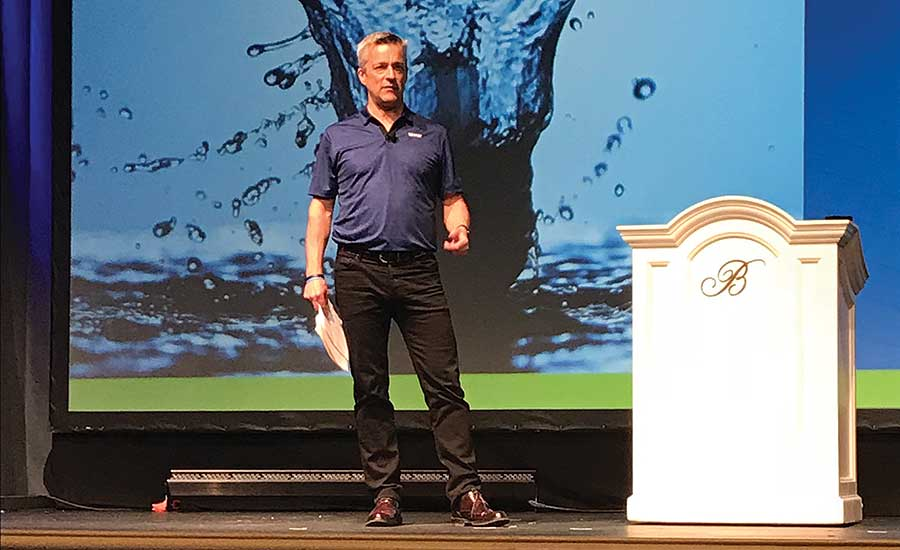Uponor North America President Bill Gray speaks to the assembled crowd at the 2018 Uponor Convention