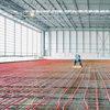 REHAU RAUPEX O2 barrier pipe being installed in an airport hangar ©REHAU